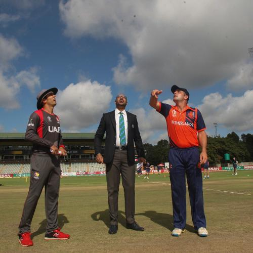 UAE captain Rohan Mustafa looks on as Peter Borren of the Netherlands tosses a coin ahead of their Group A World Cup Qualifier cricket match between United Arab Emirates and Netherlands played at Harare Sports Club, March 8 2018 (©ICC).