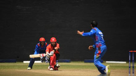 Afghanistan spin bowler Mohammad Nabi delivers a full delivery to Hong Kong batsman Scott McKechnie who plays a sweep shot at BAC in Bulawayo (©ICC).