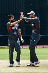 UAE bowler Muhammad Naveed celebrates a wicket with team mate Ahmed Raza in action during a Group A World Cup Qualifier cricket match played between United Arab Emirates and the Netherlands at Harare Sports Club in Harare March 8 2018 (©ICC).