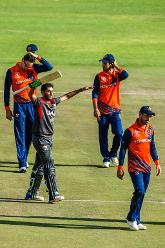 UAE batsman Chirag Suri celebrates victory in the Group A World Cup Qualifier cricket match played between United Arab Emirates and the Netherlands at Harare Sports Club in Harare March 8 2018 (©ICC).
