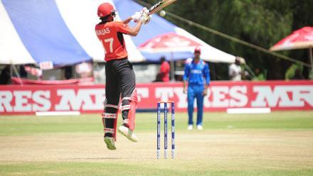 Hong Kong batsman Waqas Barkat off his feet to play a cut shot against Afghanistan pace bowler Shahpur Zadran in their Group B, ICC Cricket World Cup Qualifier at BAC in Bulawayo, Mar 8 2018 (©ICC).