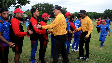 Hong Kong and Afghanistan players shake hands with the Umpires at the end of their Group B, ICC Cricket World Cup Qualifier at BAC in Bulawayo, Mar 8 2018 (©ICC).