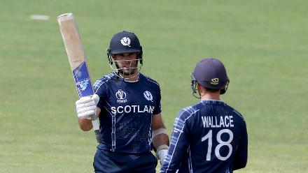 Kyle Coetzer (L) of Scotland reacts after reaching his 50 during the ICC Cricket World Cup Qualifier between Scotland v Nepal at Queens Sports Club on March 8, 2018 in Bulawayo, Zimbabwe (©ICC).