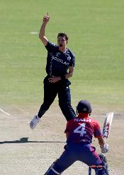 Stuart Whittingham (L) of Scotland celebrates taking the wicket of Dilip Nath of Nepal during the ICC Cricket World Cup Qualifier between Scotland v Nepal at Queens Sports Club on March 8, 2018 in Bulawayo, Zimbabwe (©ICC).