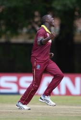 Carlos Brathwaite of The Windies celebrates the wicket of Jack Vare of Papua New Guinea during The Cricket World Cup Qualifier between The Windies and Papua New Guinea at The Old Hararians on March 8, 2018 in Harare, Zimbabwe (©ICC).