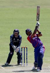 Paras Khadka (R) of Nepal plays a shot during the ICC Cricket World Cup Qualifier between Scotland v Nepal at Queens Sports Club on March 8, 2018 in Bulawayo, Zimbabwe (©ICC).