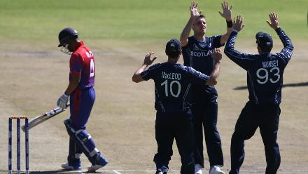 Stuart Whittingham (3rdL) of Scotland celebrates with teamates after taking the wicket of Dipendra Airee of Nepal during the ICC Cricket World Cup Qualifier between Scotland v Nepal at Queens Sports Club on March 8, 2018 in Bulawayo, Zimbabwe (©ICC).