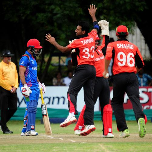 Hong Kong bowler Tanwir Afzal celebrates an LBW wicket of Afghanistan batsman Javed Ahmadi with his team mates at BAC in their Group B, ICC Cricket World Cup Qualifier in Bulawayo, Mar 8 2018 (©ICC).