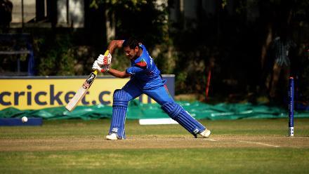 Afghanistan batsman Najibullah Zadran plays a delightful drive against Hong Kong in a Group B, ICC Cricket World Cup Qualifier at BAC in Bulawayo, Mar 8 2018 (©ICC).