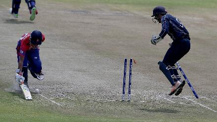 Sompai Kami (L) of Nepal is run out by Richie Berrington (unseen) of Scotland during the ICC Cricket World Cup Qualifier between Scotland v Nepal at Queens Sports Club on March 8, 2018 in Bulawayo, Zimbabwe (©ICC).