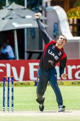 UAE captain Rohan Mustafa bowling during a group A World Cup Qualifier match between Papua New Guinea and the United Arab Emirates at Harare Sports Club March 4 2018 (©ICC).