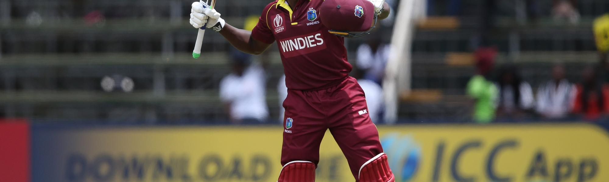 Rovman Powell of The West Indies celebrates his century during The ICC Cricket World Cup Qualifier between The West Indies and Ireland at The Harare Sports Club on March 10, 2018 in Harare, Zimbabwe (©ICC).