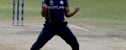 Safyaan Sharif (R) of Scotland celebrates taking the wicket of Graeme Cremer (unseen) during the ICC Cricket World Cup Qualifier between Zimbabwe and Scotland at Queens Sports Club on March 12, 2018 in Bulawayo, Zimbabwe (©ICC).