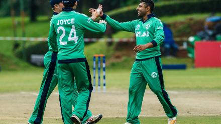 Ireland bowler Simi Singh celebrates a wicket with team mates during a World Cup Qualifier Group A cricket match between United Arab Emirates and Ireland at Old Hararians Sports Club March 12 2018 (©ICC).