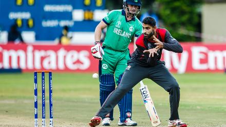 UAE bowler Ahmed Raza fields behind the stumps as William Porterfield makes ground during a Group A World Cup Qualifier cricket match between United Arab Emirates and Ireland at Old Hararians Sports Club in Harare March 12 2018 (©ICC).