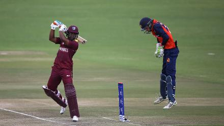Scott Edwards of The Netherlands looks on as Evin Lewis of The Windies hits out during The ICC Cricket World Cup Qualifier between The Windies and The Netherlands at The Harare Sports Club on March 12, 2018 in Harare, Zimbabwe (©ICC).