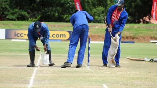 Groundsman re-paint the creases on the wicket in the last match of the Group B, ICC World Cup Qualifier between Hong Kong and Nepal at BAC in Bulawayo, Mar 12 2018 (©ICC).