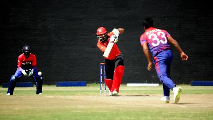 Nepal bowler Karan KC delivers to Hong Kong captain Babar Hayat during their final Group B, ICC World Cup Qualifier at BAC in Bulawayo, Mar 12 2018 (©ICC).