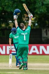 Irish batsman Paul Stirling raises his bat on reaching 100 runs during a Group A World Cup Qualifier cricket match between United Arab Emirates and Ireland at Old Hararians Sports Club in Harare March 12 2018 (©ICC).