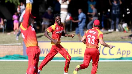 Blessing Muzarabani (C) of Zimbabwe celebrates taking the last wicket of Brad Wheal (unseen) of Scotland during the ICC Cricket World Cup Qualifier between Zimbabwe and Scotland at Queens Sports Club on March 12, 2018 in Bulawayo, Zimbabwe (©ICC).