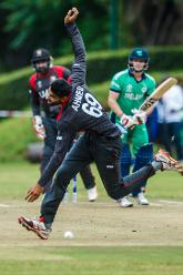 UAE bowler Ahmed Raza fields as batsman William Porterfield gets one past him during a Group A World Cup Qualifier cricket match between United Arab Emirates and Ireland at Old Hararians Sports Club in Harare March 12 2018 (©ICC).