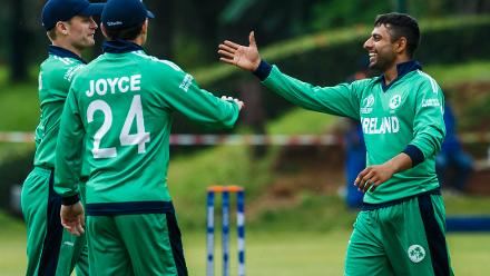 Ireland bowler Simi Singh celebrates a wicket with captain william Potterfield during a World Cup Qualifier Group A cricket match between United Arab Emirates and Ireland at Old Hararians Sports Club March 12 2018 (©ICC).