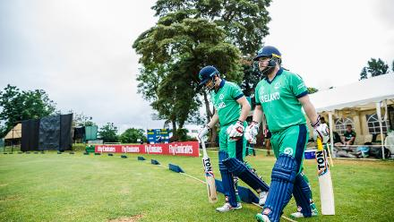 Irish opening pair of Paul Stirling (R) and captain William Porterfield walk onto the pitch during a Group A World Cup Qualifier cricket match between United Arab Emirates and Ireland at Old Hararians Sports Club in Harare March 12 2018 (©ICC).