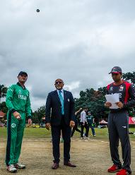 Irish captain William Porterfield (L) tosses the coin as Rohan Mustafa (R) of UAE looks on ahead of a Group A World Cup Qualifier cricket match between United Arab Emirates and Ireland at Old Hararians Sports Club in Harare March 12 2018 (©ICC).