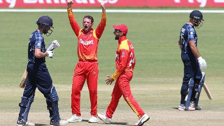 Sean Williams (2ndL) of Zimbabwe celebrates taking the wicket of Callum MacLeod (C) of Scotland during the ICC Cricket World Cup Qualifier between Zimbabwe and Scotland at Queens Sports Club on March 12, 2018 in Bulawayo, Zimbabwe (©ICC).