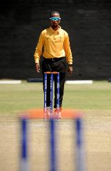 Umpire inspects the wicket in the last match of the Group B, ICC World Cup Qualifier between Hong Kong and Nepal at BAC in Bulawayo, Mar 12 2018 (©ICC).