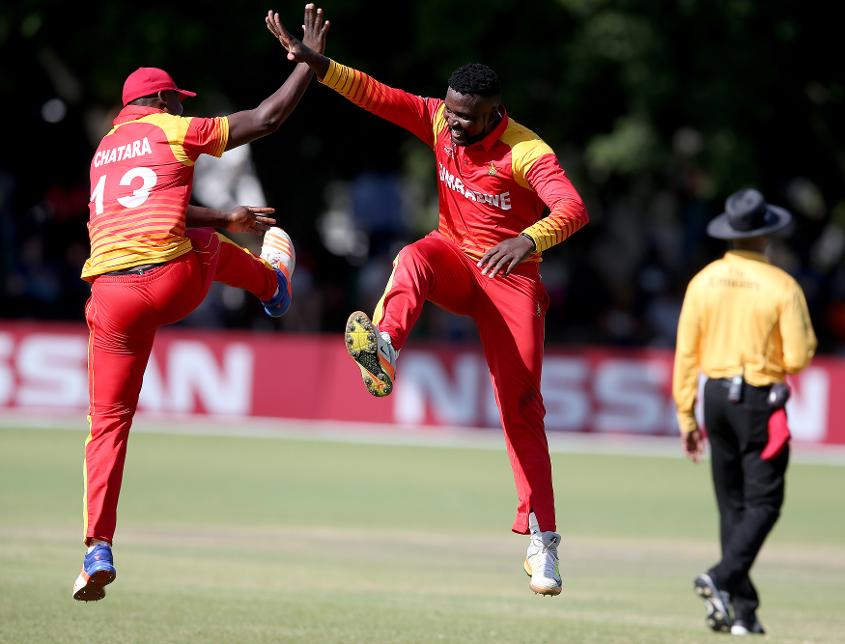 Tendai Chisoro (C) of Zimbabwe celebrates with Tendai Larry Chatara (L) after taking the wicket of Craig Wallace (unseen) of Scotland during the ICC Cricket World Cup Qualifier between Zimbabwe and Scotland at QSC on March 12, 2018 (©ICC).