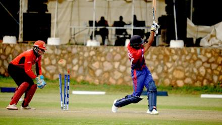 Nepal batsman Paras Khadka gets bowled by Hong Kong Bowler Tanwir Afzal in the last match of their Group B, ICC World Cup Qualifier at BAC in Bulawayo, Mar 12 2018 (©ICC).
