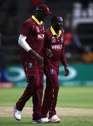 Jason Holder (L) congratulates Kesrick Williams after taking the wicket of Pieter Seelaar of The Netherlands during The ICC Cricket World Cup Qualifier between The Windies and The Netherlands at The Harare Sports Club on March 12, 2018 (©ICC).