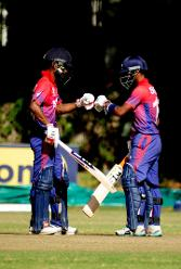 Nepal batsmen Rohit Paudel and Sompal Kami fist pump after a great partnership of 89runs against Hong Kong in the Group B, ICC World Cup Qualifier at BAC in Bulawayo, Mar 12 2018 (©ICC).
