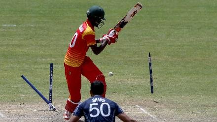 Blessing Muzarabani (L) of Zimbabwe is bowled out by Safyaan Sharif (R) of Scotland during the ICC Cricket World Cup Qualifier between Zimbabwe and Scotland at Queens Sports Club on March 12, 2018 in Bulawayo, Zimbabwe (©ICC).