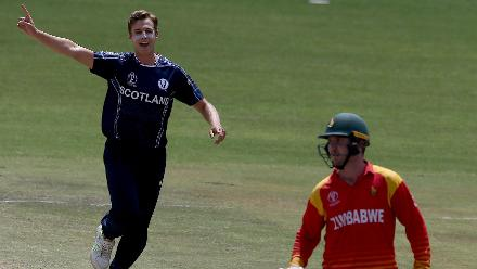 Brad Wheal (L) of Scotland celebrates taking the wicket of Brendan Taylor (R) during the ICC Cricket World Cup Qualifier between Zimbabwe and Scotland at Queens Sports Club on March 12, 2018 in Bulawayo, Zimbabwe (©ICC).