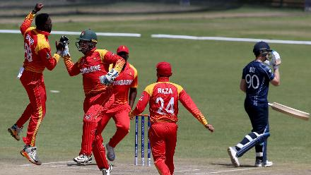 Tendai Chisoro (L) of Zimbabwe celebrates after taking the wicket of Tom Sole (R) of Scotland during the ICC Cricket World Cup Qualifier between Zimbabwe and Scotland at Queens Sports Club on March 12, 2018 in Bulawayo, Zimbabwe (©ICC).