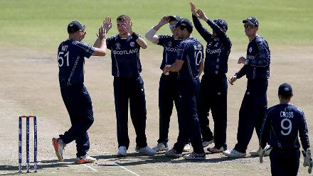 Stuart Whittingham (2ndL) of Scotland celebrates with teamates after taking the wicket of Dipendra Airee of Nepal during the ICC Cricket World Cup Qualifier between Scotland v Nepal at Queens Sports Club on March 8, 2018 in Bulawayo, Zimbabwe (©ICC).