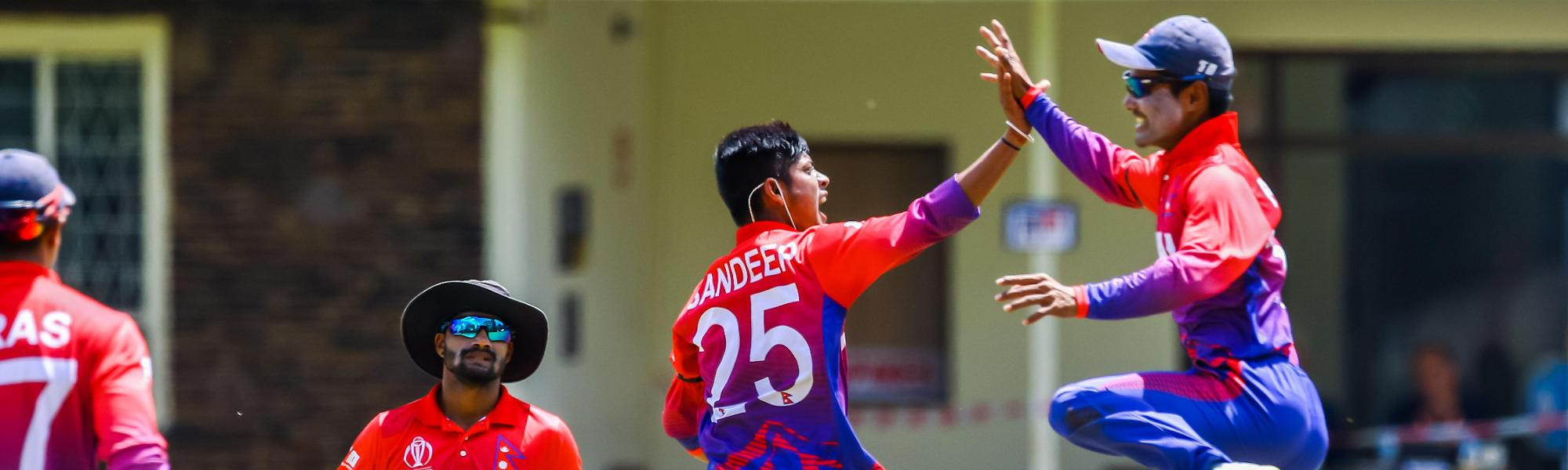 Nepal bowler Sandeep Lamichhane celebrates a wicket with team mates during a World Cup Qualifier play off cricket match between Nepal and Papua New Guinea at Old Hararians Sports Club March 15 2018 (©ICC).