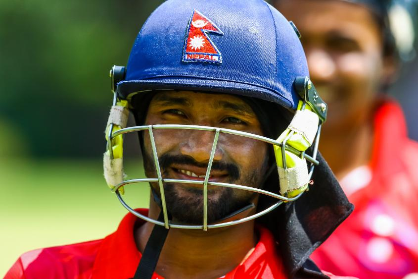 Nepal batsman Dipendra Airee leaves the field after scoring 50 runs during a World Cup Qualifier play off cricket match between Nepal and Papua New Guinea at Old Hararians Sports Club March 15 2018 (©ICC).
