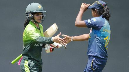 Javeria Khan is congratulated by a Sri Lankan player after reaching her century