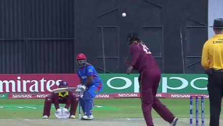 Chris Gayle picks up the wicket of Mohammad Shahzad