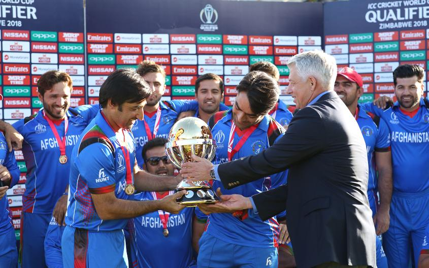 Dave Richardson of The ICC hands over the trophy to the wining Afghanistan team after The ICC Cricket World Cup Qualifier Final between The Windies and Afghanistan at The Harare Sports Club on March 25, 2018 in Harare, Zimbabwe (©ICC).