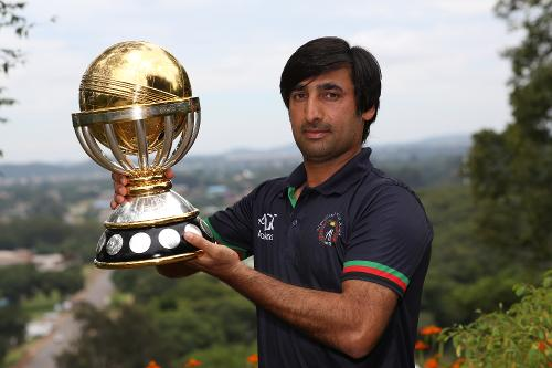 Asghar Stanikzai, the captain of Afghanistan, poses with the ICC Cricket World Cup Qualifier trophy