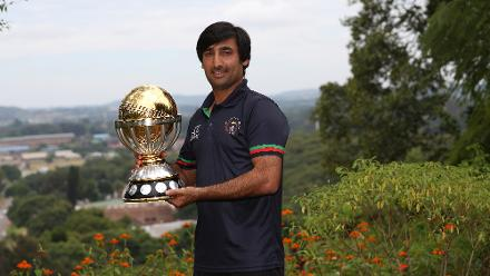 Asghar Stanikzai, the captain of the Afghanistan cricket team, poses with The ICC Cricket World Cup Qualifier trophy the day after beating The West Indies in the final on March 26, 2018 in Harare, Zimbabwe (©ICC).