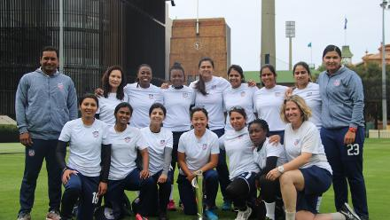 USA Women's team poses with the trophy at the Sydney Cricket Ground in Australia