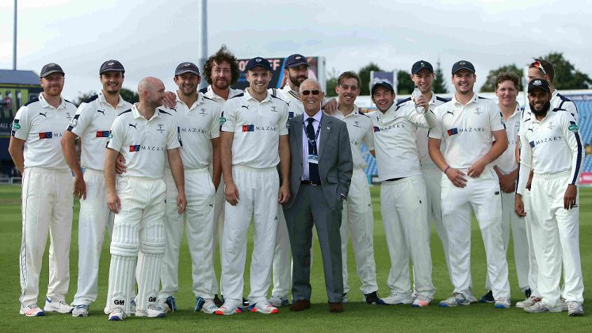 John Hampshire, then president of Yorkshire, poses with the players during the 2016-17 season