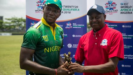 Chimezie Onwuzulike of Nigeria is presented with the Player of the Match award after an 88-run victory
