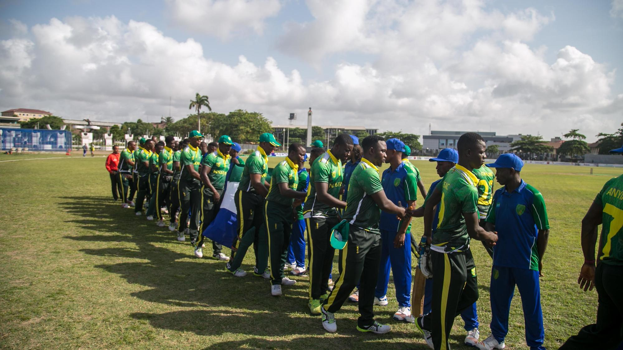 The players of Nigeria and Sierra Leone shake hands before their match