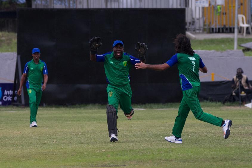 Sierra Leone's Hari Ram Bhamu celebrates a wicket with Mohamed Hansarau